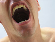 Crying out. Man with mouth wide open shouting Royalty Free Stock Photography