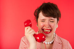 Crying on the phone Royalty Free Stock Photos