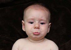 Crying Pouting sad baby looking cute Stock Photography
