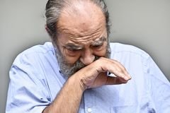 Crying Retired Male. A retired old Hispanic man Stock Images