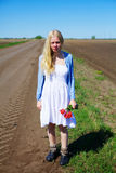 Crying russian girl in field near road Stock Image