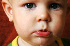 Crying sad baby. Close up of a crying, sad baby Stock Images