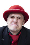 Crying sad man in red hat. Young crying sad man in red hat Stock Photography