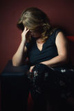 Crying sad woman alone in the dark stock photos