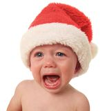 Crying Santa. Baby boy, 10 months old Stock Photo