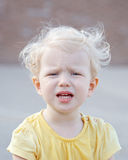 Crying screaming little white blond Caucasian toddler boy girl Royalty Free Stock Image