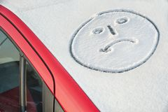 Crying smiley on snow Stock Photos