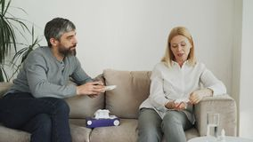 Crying stressed woman talking with professional male psychologist who gives paper tissue and trying to calm down her. Depressed woman talking with professional stock video