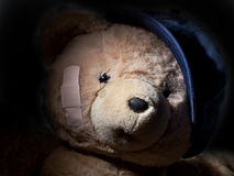 Crying Teddy Bear Hiding in Shadows Royalty Free Stock Photos