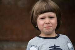 Crying Toddler Boy. Angry, upset crying toddler boy. Tears can be seen royalty free stock photography
