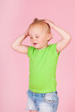 Crying Toddler girl pink. Portrait crying toddler girl on pink background stock photo