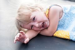 Crying toddler caucasian girl face closeup. Crying toddler caucasian girl tear-stained face closeup view royalty free stock photos