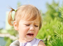 Crying toddler. Crying little toddler girl outdoors stock photos