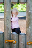 Crying toddler outdoor. Little child girl crying on playground in loneliness. Childhood problems concept royalty free stock photo