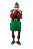 Crying Upset Elf. A full body shot of a male elf rubbing his eyes crying and upset. shot on white Royalty Free Stock Photo