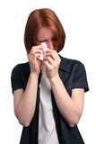 Crying Woman. A young woman wiping away her tears Royalty Free Stock Images