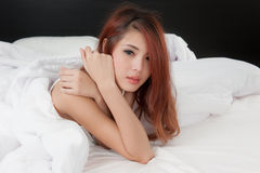 Crying woman on bed Stock Image