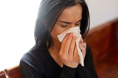 Crying woman blowing nose with wipe at funeral day Stock Image