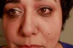 Crying woman close up. Close up view of ethnic woman with short hair showing crying expression Royalty Free Stock Photography