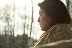 Crying woman. Close-up of young depressed crying woman sitting alone Stock Image