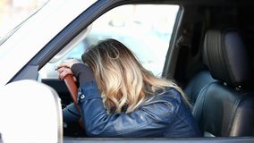 Crying woman driver stock video