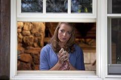 Crying Woman Drying Dish At Kitchen Window Stock Photos