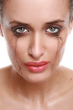 Crying woman with flowing make-up Stock Photos