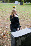 Crying Woman In Cemetery Stock Photo