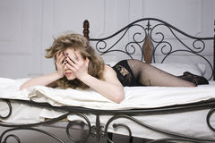 Crying woman laying in bed Royalty Free Stock Photos