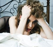 Crying woman laying in bed, winter depression holding head with. Hands, having hangover close up royalty free stock images