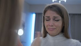 Crying woman in mirror looking at herself, weeping. 4k , high quality stock video footage