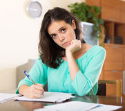 Crying  woman reading  documents Stock Image