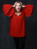 Crying woman in res dress, dramatic pose, hands on the head Royalty Free Stock Images