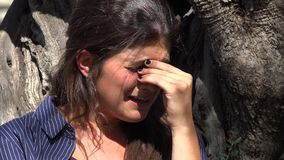 Crying Woman And Sadness. A young and pretty hispanic woman stock footage