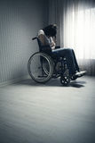 Crying woman sitting in wheelchair Stock Image