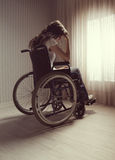 Crying woman sitting in wheelchair Stock Photography