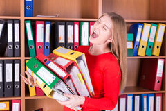 Crying woman with stack of folders Royalty Free Stock Photos