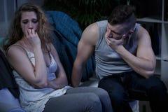 Crying woman and terrified husband royalty free stock image