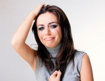 Crying woman towards. Grey background Royalty Free Stock Images