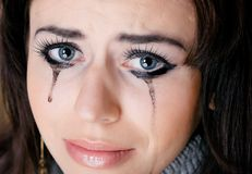 Crying woman towards Royalty Free Stock Image