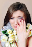 Crying woman with white flowers tulips Stock Photography