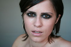 Crying for you. Face portrait of a young brunette woman crying royalty free stock photography