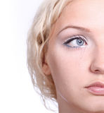 Crying young blond woman Stock Photos