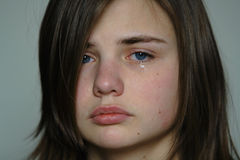 Crying young woman stock photos