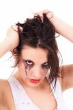 Crying young woman with flowed mascara Stock Image