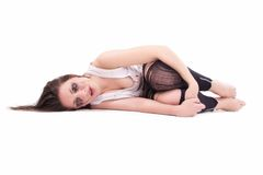 Crying young woman lying, in torn clothes. Isolated on white Stock Photo