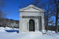 Crypt in Snow Covered Cemetery Stock Image