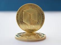 Crypto νομίσματα νομίσματος νεω στο μπλε υπόβαθρο 2 στοκ φωτογραφία