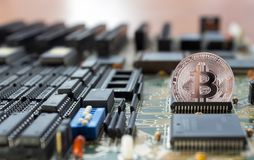 Crypto bitcoin exits from the integrated circuit. Crypto currency bitcoin exits from the integrated circuit from  motherboard Stock Photos