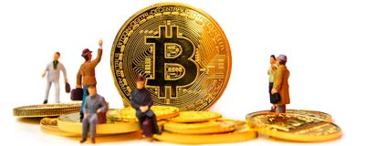 Crypto currencies, bitcoin especially is the possibility to get rich. Closeup of golden bitcoin coin on white background with many golden coins at bottom and Royalty Free Stock Photos